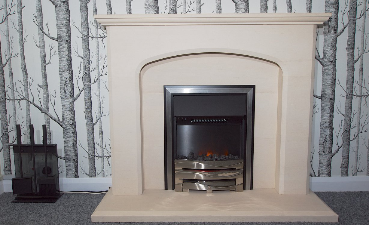 An electric fire in a traditional limestone fireplace
