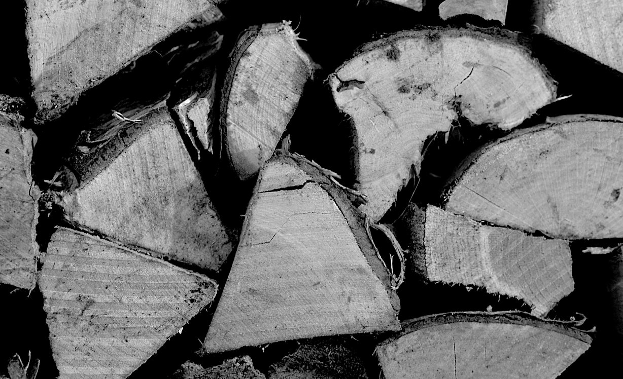 A black and white image of some kiln dried log ends
