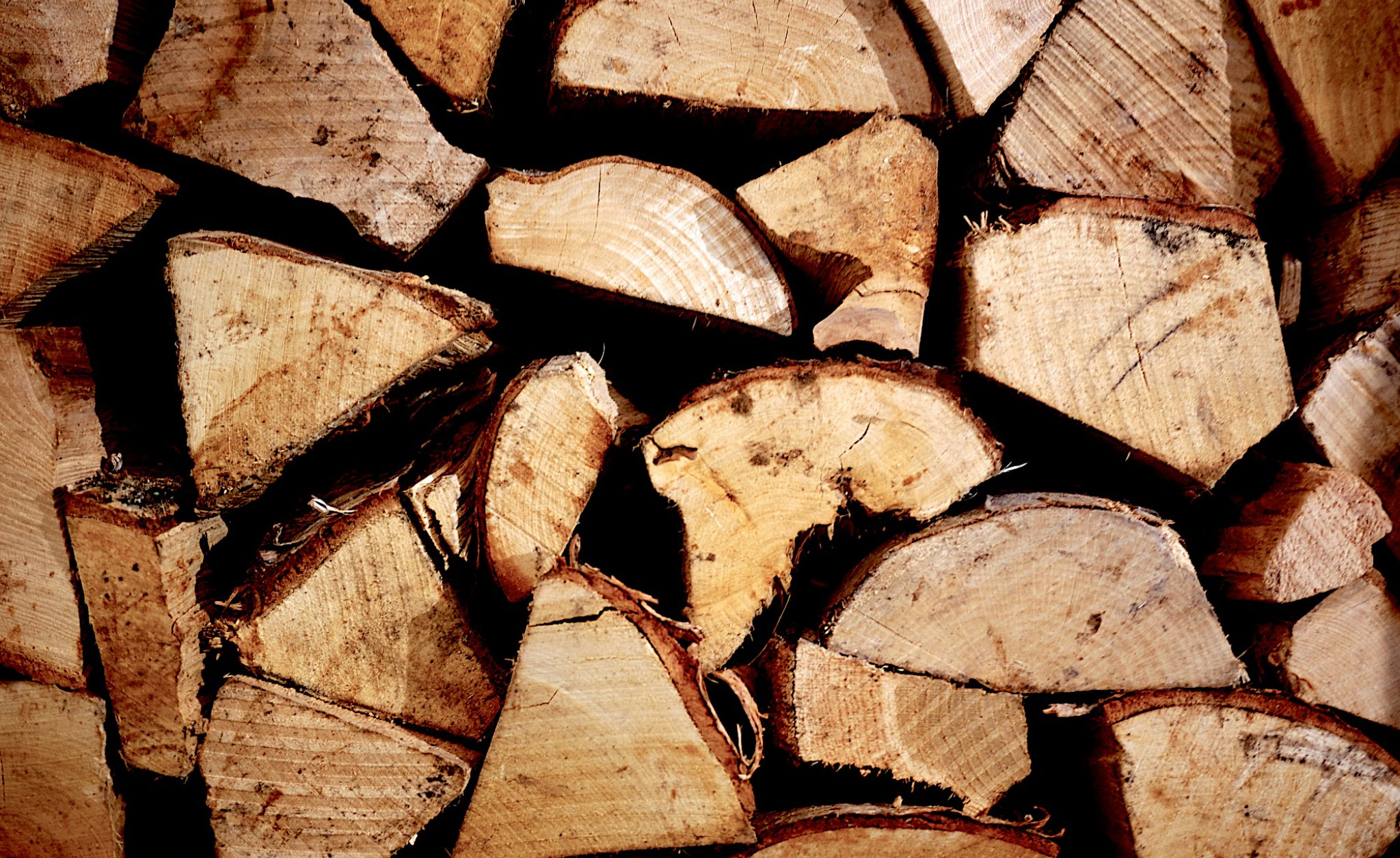 Image showing kiln dried logs stacked in a pile
