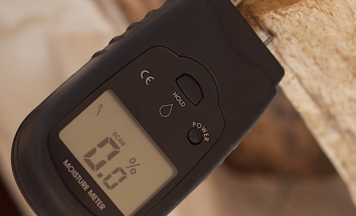 An image of a moisture meter in a kiln dried log
