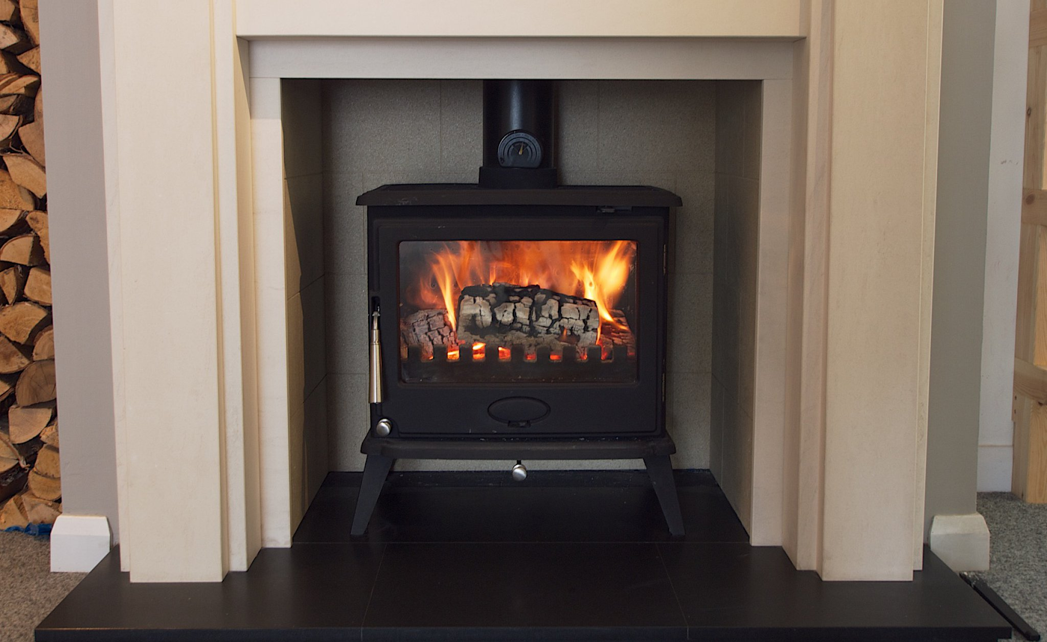 A Newman wood burning stove burning efficiently with kiln dried logs