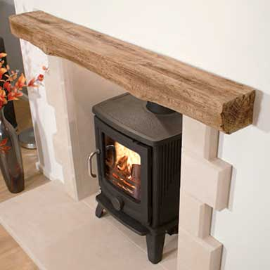 A timber-effect beam with a wood burning stove